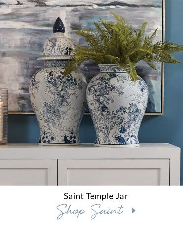 Classic ocean spray and koi scene are depicted on the elegant proportions of this porcelain temple jar