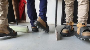 Coating concrete floors now even easier with Flexible spiked shoes