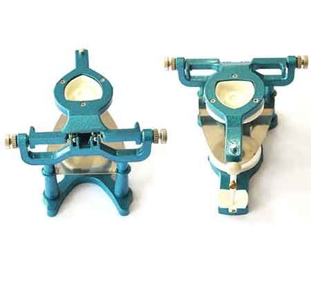 Articulator with magnetic retention
