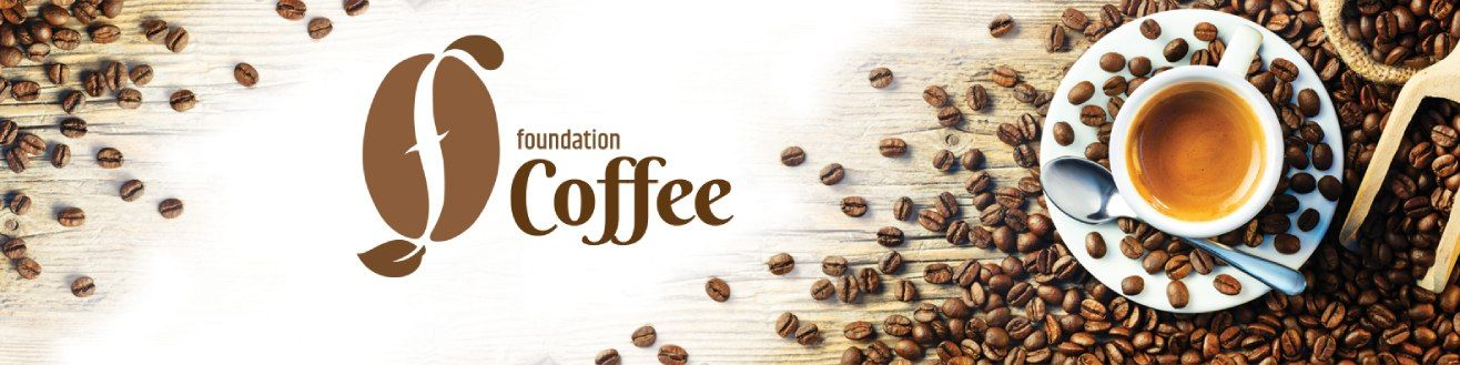 roasted coffee beans around a cup with foundation coffee logo