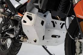 SKID PLATE SW MOTECH 4MM ALUMINUM ALLOY PROTECTS THE ENGINE FROM STONE CHIPPING AND GROUND CONTACT