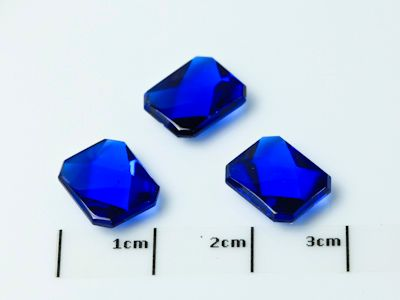 Bright Blue Syn Spinel Buff-Top 10x8mm Emerald  (S)