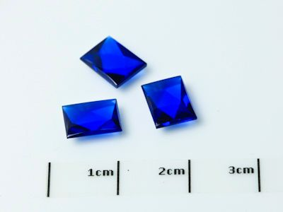 Bright Blue Syn Spinel Buff-Top 8x6mm Baguette (S)