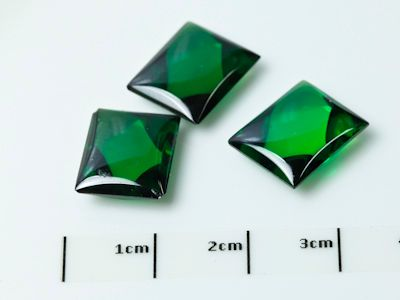 Syn Green CZ Buff-Top 12x10mm Baguette (S)