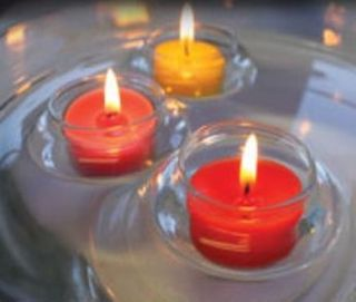 4 FLOATING CANDLE HOLDERS
